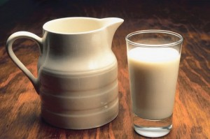 Photo of a pitcher and a glass of milk