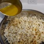 Buttering the popcorn
