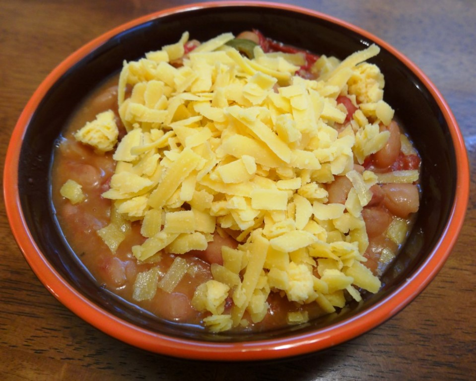 Pinto beans with shredded cheddar cheese