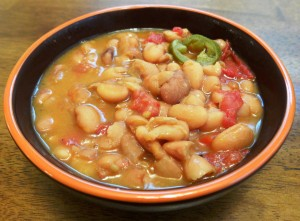 Bowl of pintos with tomatoes and jalapeno