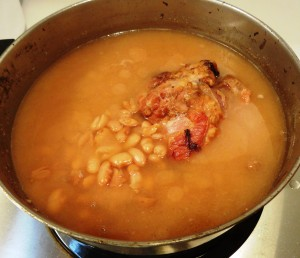 Pot of pinto beans cooked with ham hock